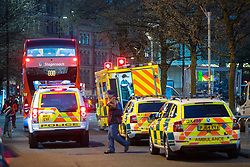 © Licensed to London News Pictures . 07/04/2017 . Manchester , UK . Police and paramedic vehicles on Piccadilly . Greater Manchester Police have authorised dispersal powers and say they will ban people from the city centre for 48 hours , this evening (7th April 2017) , in order to tackle alcohol and spice abuse . Photo credit : Joel Goodman/LNP