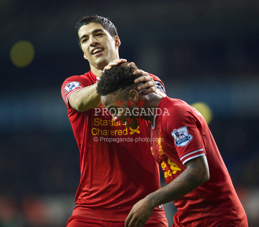 LONDON, ENGLAND - Sunday, December 15, 2013: Liverpool's Raheem Sterling celebrates scoring the fifth goal against Tottenham Hotspur with team-mate captain Luis Suarez during the Premiership match at White Hart Lane. (Pic by David Rawcliffe/Propaganda)