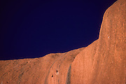 "Ayers Rock (known to the Aborigines as ""Uluru"")."
