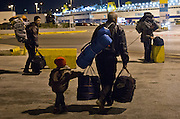 Greece, Athen, Pireaus<br /> <br /> A syrian family stranded in Pireaus Harbor packed their lagguage and moves on to Athens.<br /> They will travel by train as far as they can up north to Thessaloniki. From there they will go further to Idomeni.<br /> Kids had to walk day or night, move from one place to another location.Like this boy who holds with one hand the bag, and walks as fast as he can behind his father and brothers.<br />  <br /> Since the border between Greece and and FYROM (Macedonia) was closed some of the refugees, stay in Athens.<br /> <br /> <br /> keine Veroeffentlichung unter 50 Euro*** Bitte auf moegliche weitere Vermerke achten***Maximale Online-Nutzungsdauer: 12 Monate !!