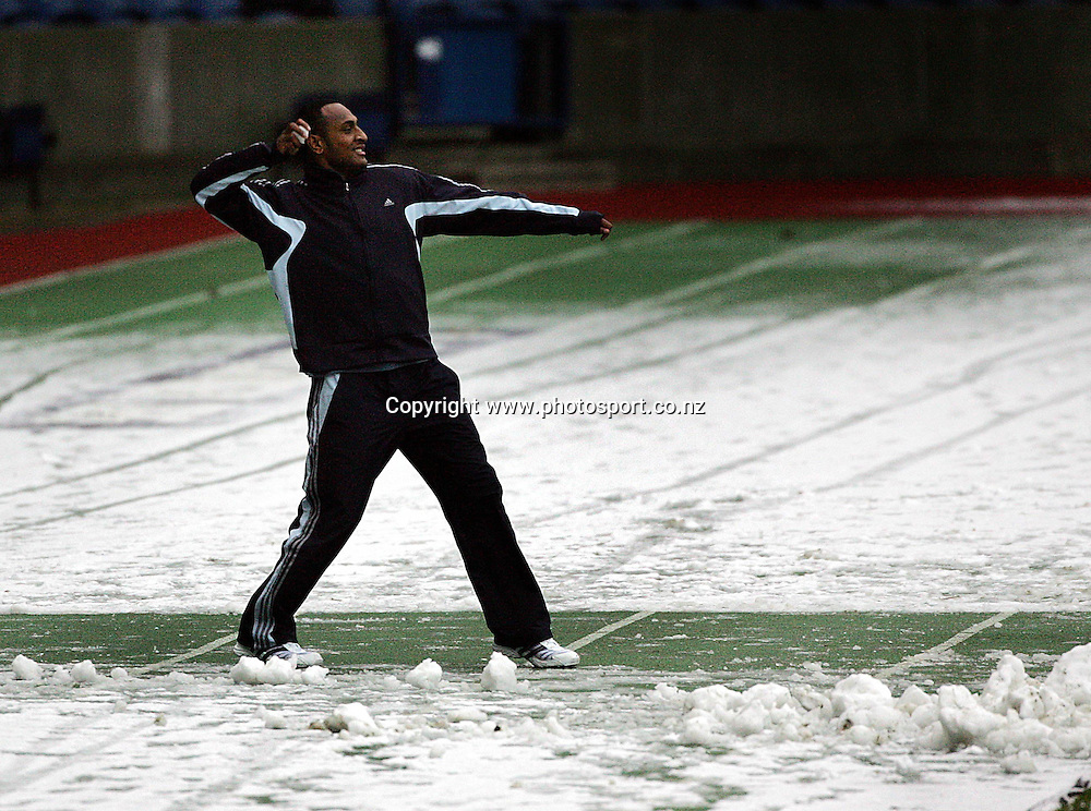 All Black winger Joe Rokocoko prepares to throw a snowball at the captain's run at Murrayfield, Edinburgh, Scotland, Friday 25 November 2005, prior to tomorrows All Blacks rugby union test match versus Scotland.Photo: Andrew Cornaga/Photosport.