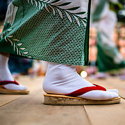 Women dance at a shrine in Nagoya, Japan, during July Bon celebrations. Bon is a tradtional Japanese holiday held in July and August.