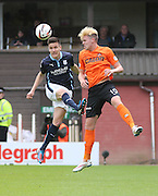 \YK\ heads clear from Dundee United's Robbie Muirhead - Dundee United v Dundee at Tannadice Park in the SPFL Premiership<br /> <br />  - &copy; David Young - www.davidyoungphoto.co.uk - email: davidyoungphoto@gmail.com