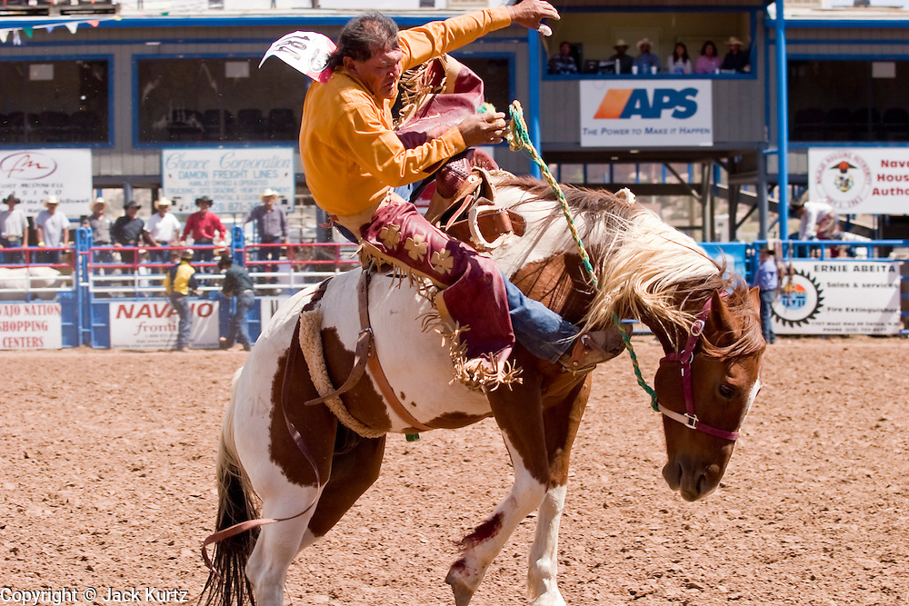 10 SEPTEMBER 2004 - WINDOW ROCK, AZ: Bronc riding at the All Indian seniors rodeo, open to cowboys more than 40 years old, during the 58th annual Navajo Nation Fair in Window Rock, AZ. The Navajo Nation Fair is the largest annual event in Window Rock, the capitol of the Navajo Nation, the largest Indian reservation in the US. The Navajo Nation Fair is one of the largest Native American events in the United States and features traditional Navajo events, like fry bread making contests, pow-wows and an all Indian rodeo.  PHOTO BY JACK KURTZ