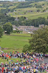 © Licensed to London News Pictures. 06/07/2014. Oxenhope nr Bradford, UK. Tour de France, 2nd Stage.The 7 man leading break had under 4 minutes lead over the main field as they climbed their way up out of Oxenhope in Brontë country to scale the 3rd category hill of Oxenhope Moor before heading down to Hebden Bridge. Photo credit : Ian Homer/LNP