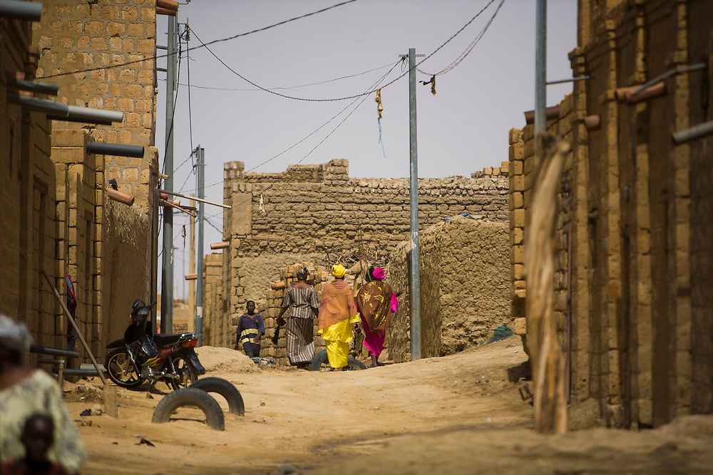 Women wearing colorful clothing on a street  in Timbuktu, Mali,