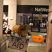 A first aid tent set up by protestors on one side of the square, outside Natwest Bank. The London Stock Exchange was attempted occypied in solidarity with Occupy Wall in Street in New York and in protest againts the economic climate, blamed by many on the banks. Police managed to keep people away fro the Patornoster Sqaure and the Stcok Exchange and thousands of protestors stayid in St. Paul's Square, outside St Paul's Cathedral. Many camped getting ready to spend the night in the square.
