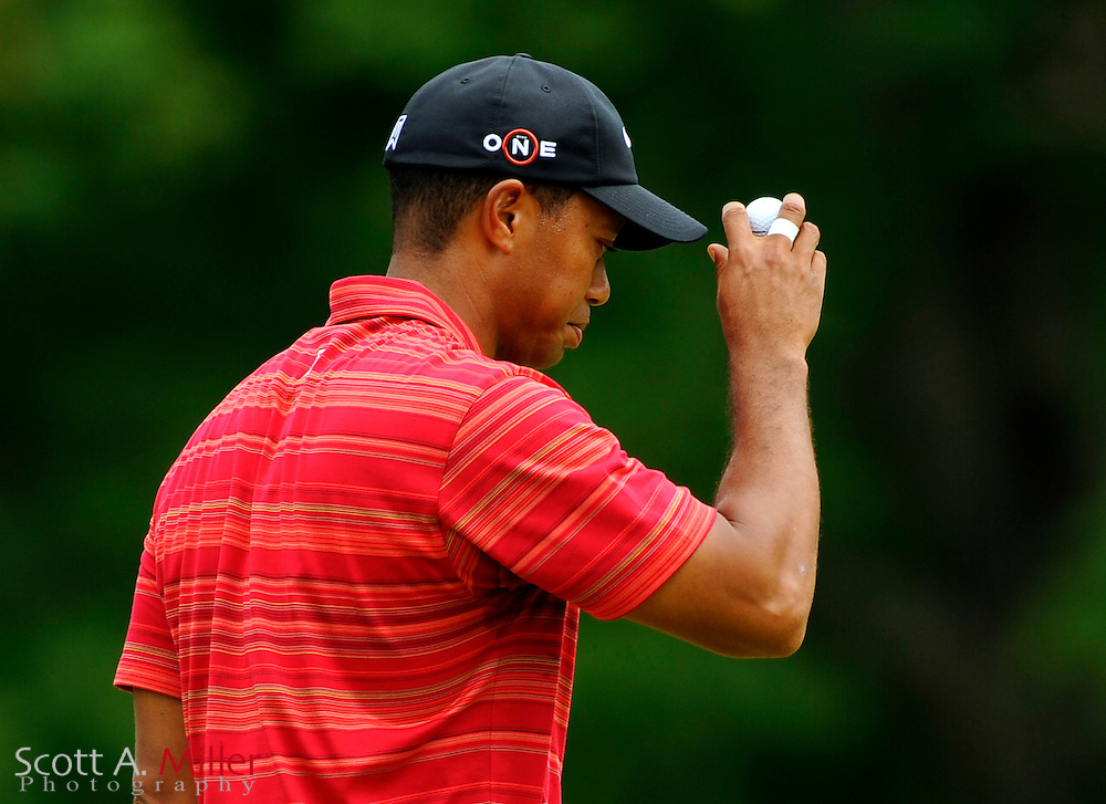 Aug 16, 2009; Chaska, MN, USA; Tiger Woods (USA) tips his cap to the crowd after putting on the third green during the final round of the 2009 PGA Championship at Hazeltine National Golf Club.  ©2009 Scott A. Miller