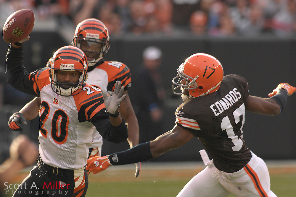 Nov. 26, 2006; Cleveland, OH, USA; Cincinnati Bengals defender (20) Tory James celebrates as he intercepts a pass intended for Cleveland Browns receiver (17) Braylon Edwards in the second half of the Bengals 30-0 win over the Browns at Cleveland Browns Stadium. ©2006 Scott A. Miller