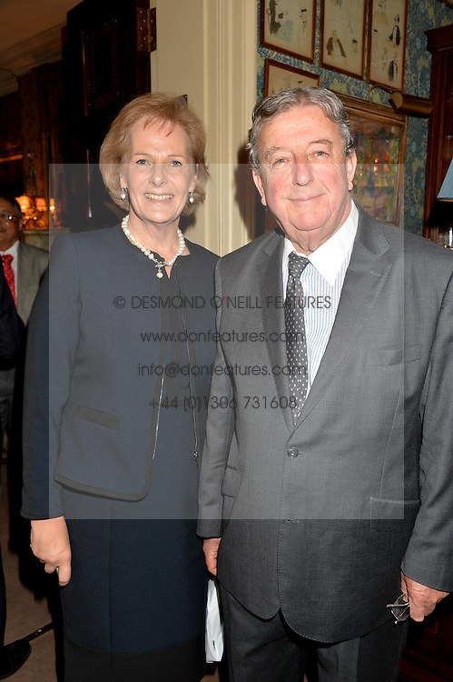 LORD & LADY WAKEHAM at a party to celebrate the publication of Right or Wrong: The Memoirs of Lord Bell held at Mark's Club, Charles Street, London on 16th October 2014.