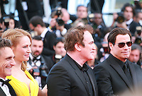 Lawrence Bender, Uma Thurman, Quentin Tarantino, John Travolta at Sils Maria gala screening red carpet at the 67th Cannes Film Festival France. Friday 23rd May 2014 in Cannes Film Festival, France.
