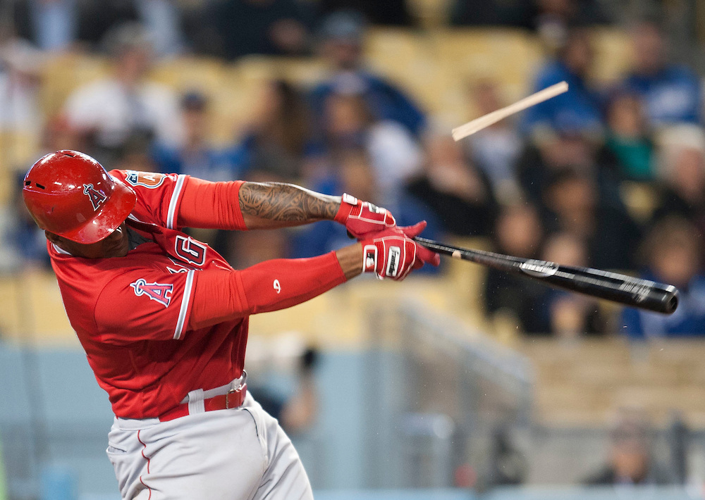 The Angels' Jefry Marte breaks his bat during the Angels' Freeway Series game against the Dodgers Thursday night at Dodger Stadium.<br /> <br /> ///ADDITIONAL INFO:   <br /> <br /> freeway.0401.kjs  ---  Photo by KEVIN SULLIVAN / Orange County Register  --  3/31/16<br /> <br /> The Los Angeles Angels take on the Los Angeles Dodgers at Dodger Stadium during the Freeway Series Thursday.<br /> <br /> <br />  3/31/16