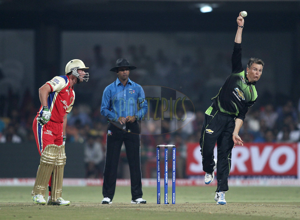 Johan Botha of the Warriors sends down a delivery during match 1 of the NOKIA Champions League T20 ( CLT20 )between the Royal Challengers Bangalore and the Warriors held at the  M.Chinnaswamy Stadium in Bangalore , Karnataka, India on the 23rd September 2011..Photo by Shaun Roy/BCCI/SPORTZPICS