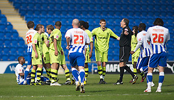 COLCHESTER, ENGLAND - Saturday, April 24, 2010: Tranmere Rovers' and Colchester United's players surround Tranmere's Joss Labadie after he is alleged to have headbutt Colchester's Kevin Lisbie during the Football League One match at the Western Community Stadium. (Photo by Gareth Davies/Propaganda)
