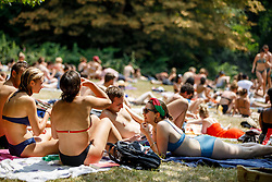 © Licensed to London News Pictures. 01/07/2018. London, UK. People sunbathe in Hampstead Heath Park in north London on Sunday, July 1, 2018 as heatwave has reached 31C and is set to continue into the next week and the unusually high temperatures look set to remain until the week after next. Photo credit: Tolga Akmen/LNP