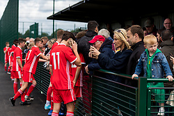 WREXHAM, WALES - Thursday, August 15, 2019: Wales players speak with supporters after the UEFA Under-15's Development Tournament match between Wales and Northern Ireland at Colliers Park. (Pic by Paul Greenwood/Propaganda)