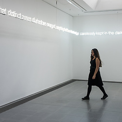 London, UK - 15 September 2014: a member of the staff walks during the press preview of the new exhibition by Cerith Wyn Evans at Serpentine Sackler Gallery.