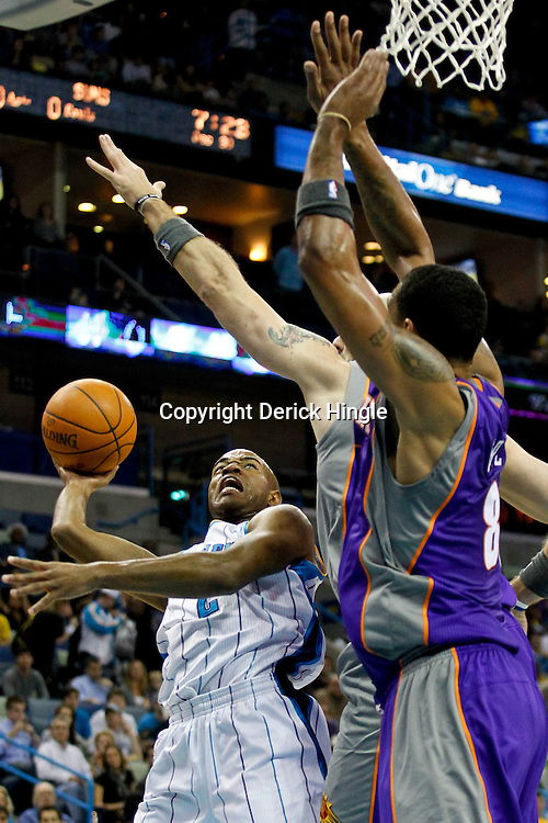 December 30, 2011; New Orleans, LA, USA; New Orleans Hornets point guard Jarrett Jack (2) shoots over Phoenix Suns center Marcin Gortat (4) and forward Channing Frye (8) during the first quarter of a game at the New Orleans Arena.   Mandatory Credit: Derick E. Hingle-US PRESSWIRE