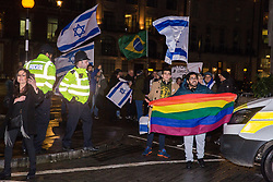 London, UK. 8th February, 2019. Pro-Israel activists hold a counter-protest to a 'Love Eurovision, Hate Apartheid!' protest by pro-Palestinian activists outside BBC Broadcasting House organised by London Palestine Action.