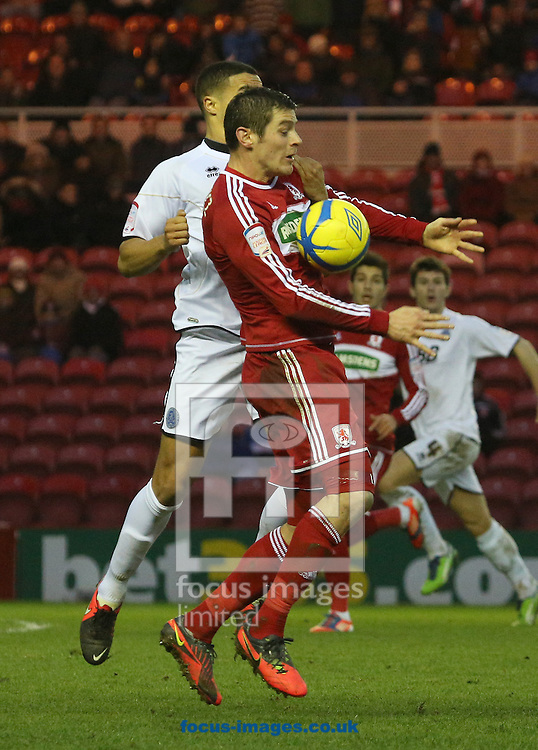 Picture by Paul Gaythorpe/Focus Images Ltd +447771 871632.26/01/2013.Lukas Jutkiewicz of Middlesbrough and Troy Brown of Aldershot Town during the FA Cup match at the Riverside Stadium, Middlesbrough.