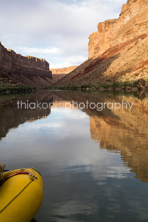 Yellow raft adds graphic element and context to Grand Canyon reflections, Colorado River, AZ