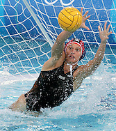 Italian goalkeeper Georgia Ellinaki stretches out of the water to defend a shot on goal by Greece during the gold medal match between Greece and Italy in the Women's Water Polo final at the Olympic Aquatic Centre in Athens Thursday 26 August 2004.  Italy won the gold medal in a close 10-9 match. (Photo by Patrick B. Kraemer / MAGICPBK)