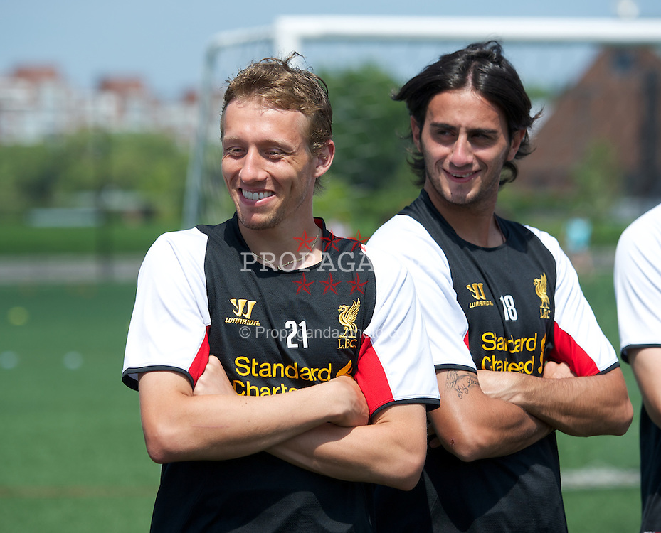 BOSTON, MA - Monday, July 23, 2012: Liverpool's Lucas Leiva and Alberto Aquilani during a LFC Foundation event at Harvard Stadium fields during the club's North American pre-season tour. (Pic by David Rawcliffe/Propaganda)