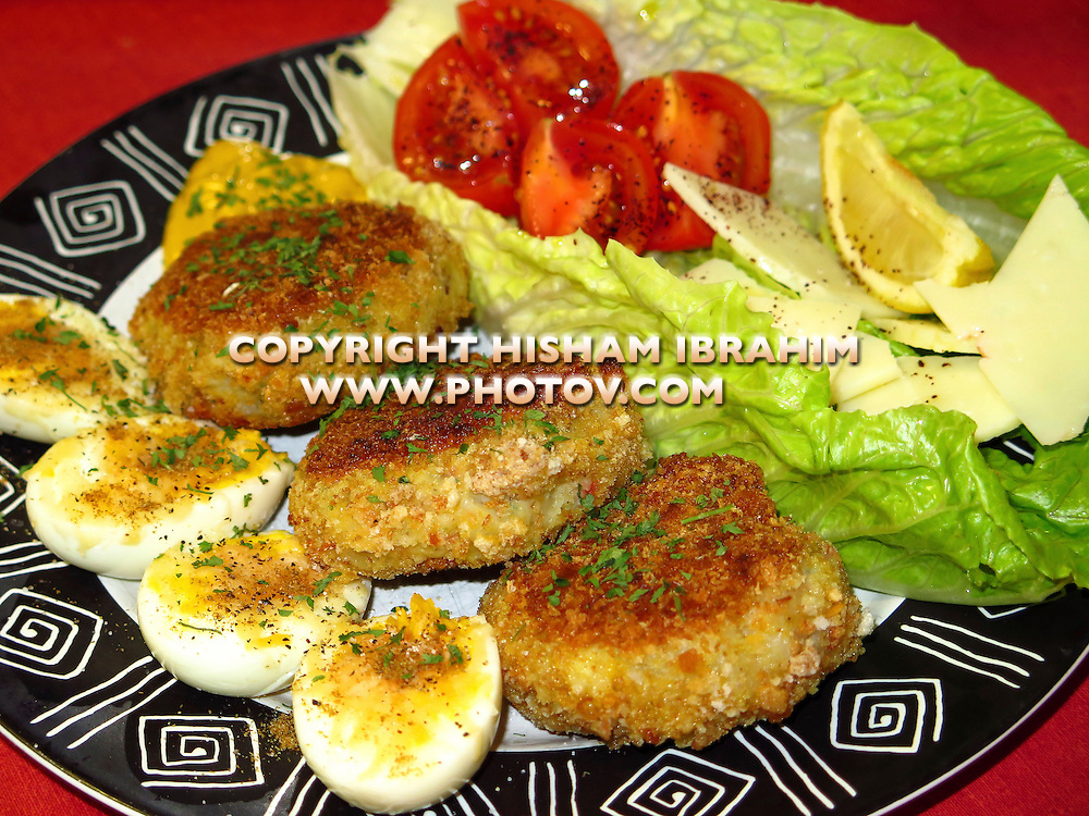 Mashed potato balls stuffed with cilantro and spices along with boiled eggs, tomatoes, cheese, lemon and lettuce - Middle Eastern Food.