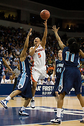 Virginia guard Sharnee Zoll (5) shoots a jumper in the lane over Old Dominion guard T.J. Jordan (23).  The #11 ranked / #5 seed Old Dominion Lady Monarchs defeated the #24 ranked / #4 seed Virginia Cavaliers 88-85 in overtime in the second round of the 2008 NCAA Women's Basketball Championship at the Ted Constant Convocation Center in Norfolk, VA on March 25, 2008.