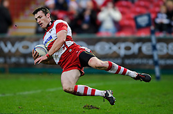 Gloucester Winger (#11) Shane Monahan scores his second try during the first half of the match - Photo mandatory by-line: Rogan Thomson/JMP - Tel: Mobile: 07966 386802 15/12/2012 - SPORT - RUGBY - Kingsholm Stadium - Gloucester. Gloucester Rugby v London Irish - Amlin Challenge Cup Round 4.