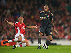 LONDON, ENGLAND - Wednesday, October 28, 2009: Liverpool's David Ngog is tackled by Arsenal's Mikael Silvestre during the League Cup 4th Round match at Emirates Stadium. (Photo by David Rawcliffe/Propaganda)