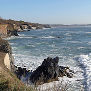 The Cliff Walk in Newport, Rhode Island, USA, affords a three and one-half mile walk at the edge of seaside bluffs and allows for the viewing of 64 private residences a number of which were built in the late 19th and early 20th centuries as summer cottages for the industrialists of the time.