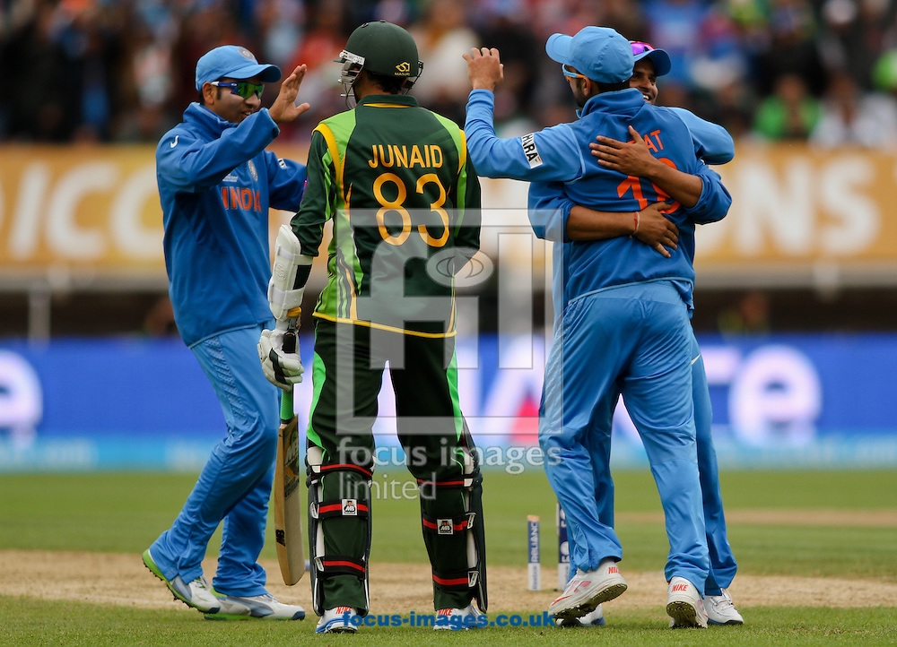 Picture by Tom Smith/Focus Images Ltd 07545141164<br /> 15/06/2013 India celebrate the wicket of Junaid Khan (centre left) of Pakistan during the ICC Champions Trophy match at Edgbaston, Birmingham.
