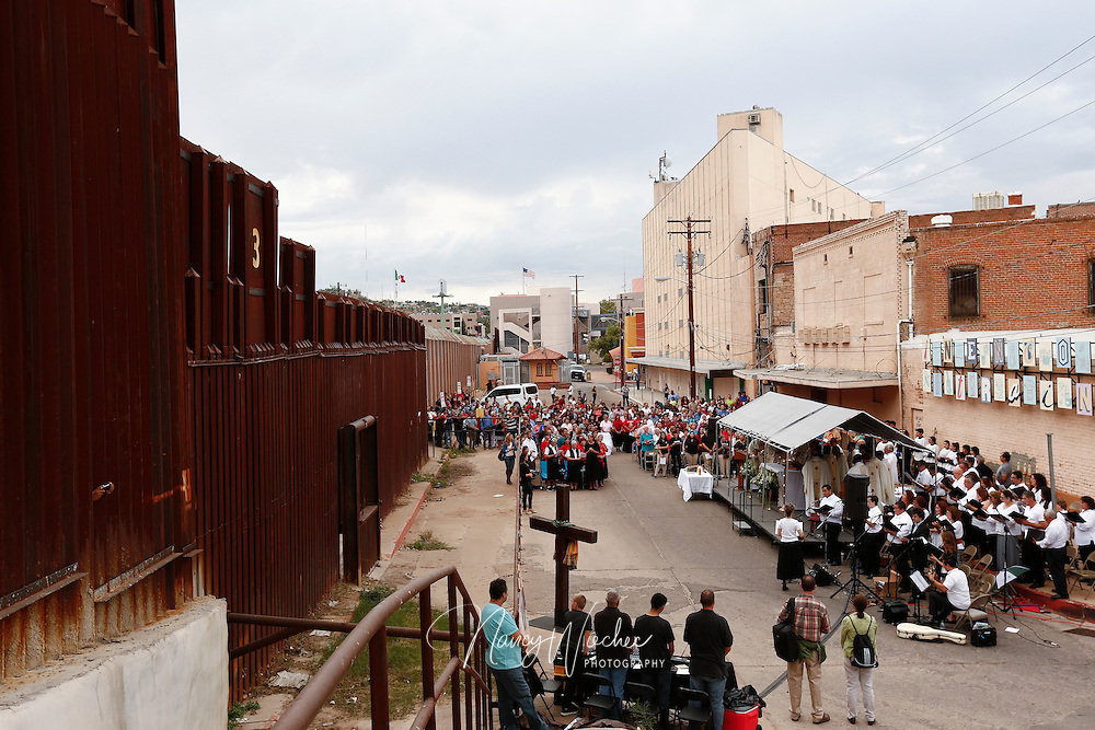 People gather for Mass at the international border in Nogales, Arizona, Oct. 23. The liturgy held on both sides of the border was concelebrated by Archbishop Christophe Pierre, apostolic nuncio to the United States, and the bishops of Tucson, Arizona,  and Nogales, Sonora. (CNS photo/Nancy Wiechec)