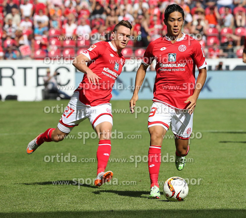 29.08.2015, Coface Arena, Mainz, GER, 1. FBL, 1. FSV Mainz 05 vs Hannover 96, 3. Runde, im Bild v.l.: Christian Clemens und Torschuetze Yoshinori Muto (beide MZ) // during the German Bundesliga 3rd round match between 1. FSV Mainz 05 and Hannover 96 at the Coface Arena in Mainz, Germany on 2015/08/29. EXPA Pictures &copy; 2015, PhotoCredit: EXPA/ Eibner-Pressefoto/ Neurohr<br /> <br /> *****ATTENTION - OUT of GER*****