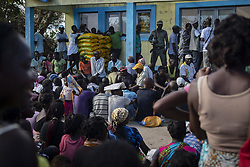 April 6, 2019 - Nhagau, Mozambique - Villagers wait for food aid to be distributed in the aftermath of the massive Cyclone Idai April 6, 2019 in Nhagau, Mozambique. The World Food Programme, with help from the U.S. Air Force is transporting emergency relief supplies to assist the devastated region. (Credit Image: © Chris Hibben via ZUMA Wire)
