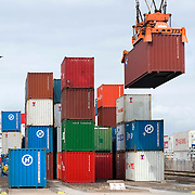 ECT Delta terminal in de haven van Rotterdam. Kranen tillen de containers naar de overslaglokatie..ECT,European Container Terminals, at the Port of Rotterdam. Europe's biggest and most advanced container terminal operator, handling close to three- quarters of all containers passing through the Port of Rotterdam. ECT is a member of the Hutchison Port Holdings group (HPH), the world biggest container stevedore with terminals on every Continent. . In the stack, unmanned automated stacking cranes ( ASCs ) ensure that the containers are always stacked in the correct place. Terminal operations are highly automated for discharging and loading large volumes...Holland, The Netherlands, dutch, Pays Bas, Europe .Foto: David Rozing