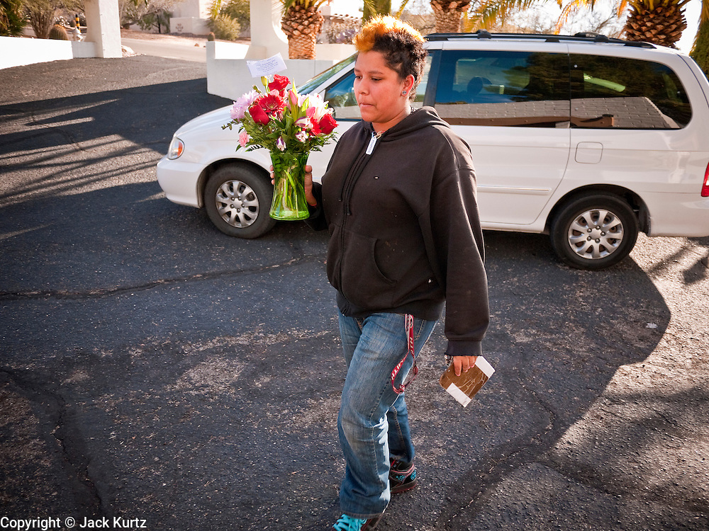 tucsonshooting - 11 JANUARY 2011 - TUCSON, AZ: Mia Timan (CQ) from Flowerbee delivers flowers to the Green family Tuesday. Christina Green was killed in the mass shooting in Tucson Saturday.  ARIZONA REPUBLIC PHOTO BY JACK KURTZ mass shooting Gabrielle Giffords shooting