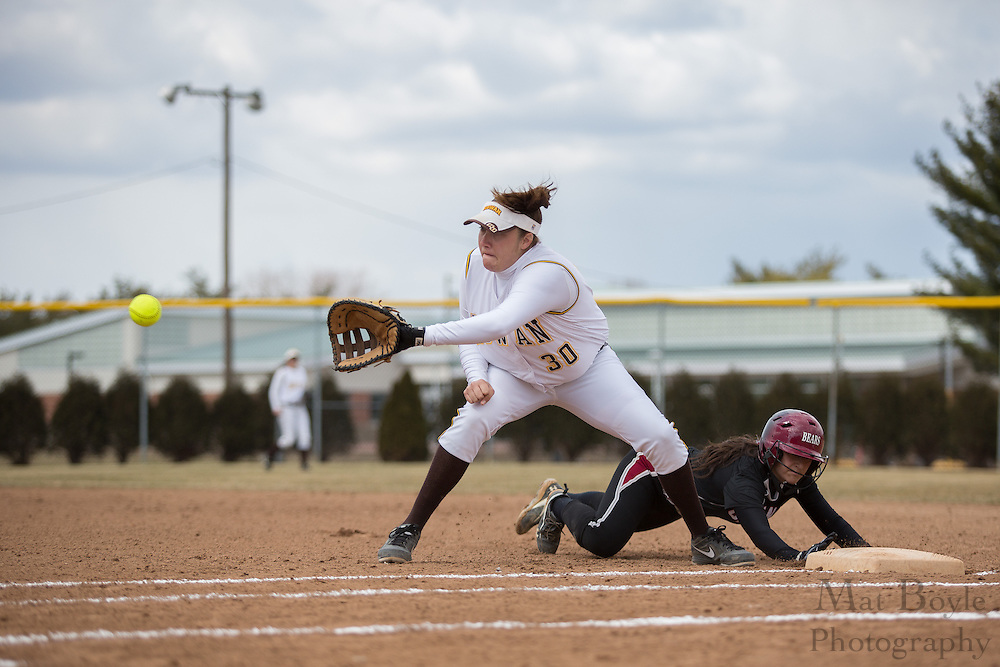 Rowan University Softball Senior Infielder Stephanie Labas (30) attempts to tag out Ursinus College Softball Sophomore shortstop Monica Bonitatis (7) as she dives back to first during a game between Ursinus College Softball and Rowan University at Rowan University's Sotball Field in Glassboro, NJ on Wednesday March 27, 2013. (photo - Mat Boyle/)