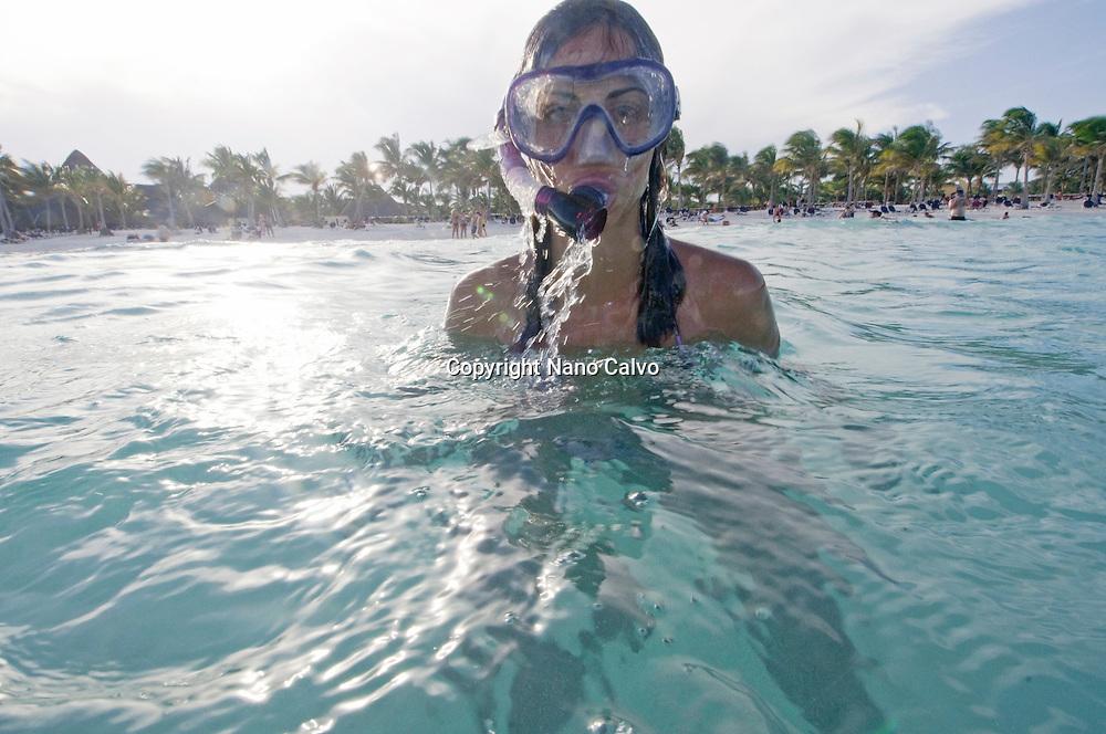 MR Young woman snorkelling in Riviera Maya, Yucatan Peninsula, Mexico