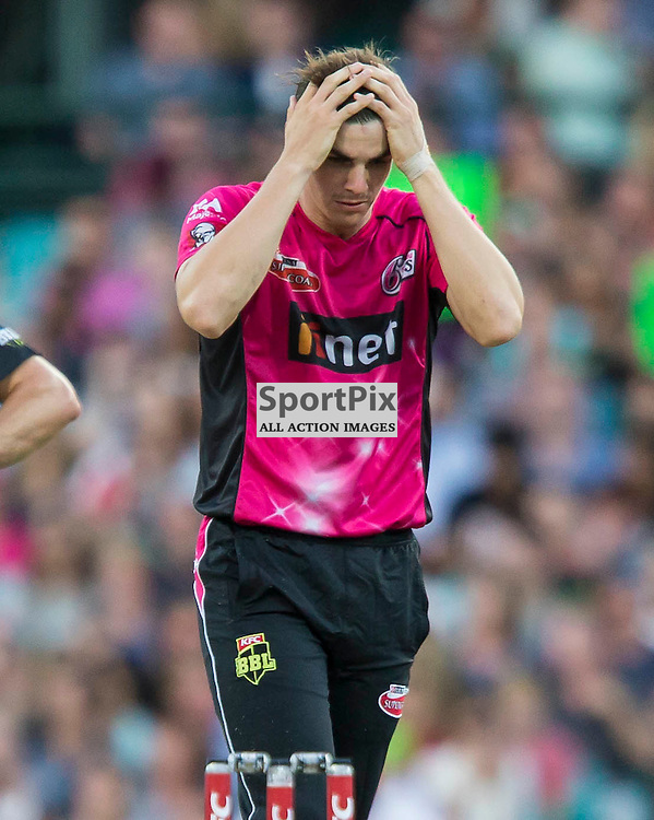 KFC Big Bash League T20 2015-16 , Sydney Sixers v Sydney Thunder, SCG; 16 January 2016<br /> Sydney Sixers Sean Abbott is frustrated by another Sydney Thunder Mike Hussey 4