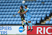 Forest Green Rovers Theo Archibald(18) and Coventry City defender Jordon Thompson (27)  jump for the ball during the EFL Trophy match between Coventry City and Forest Green Rovers at the Ricoh Arena, Coventry, England on 9 October 2018.