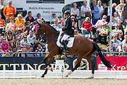 Sanne Henningsen - Superman W<br /> FEI World Breeding Dressage Championships for Young Horses 2012<br /> © DigiShots