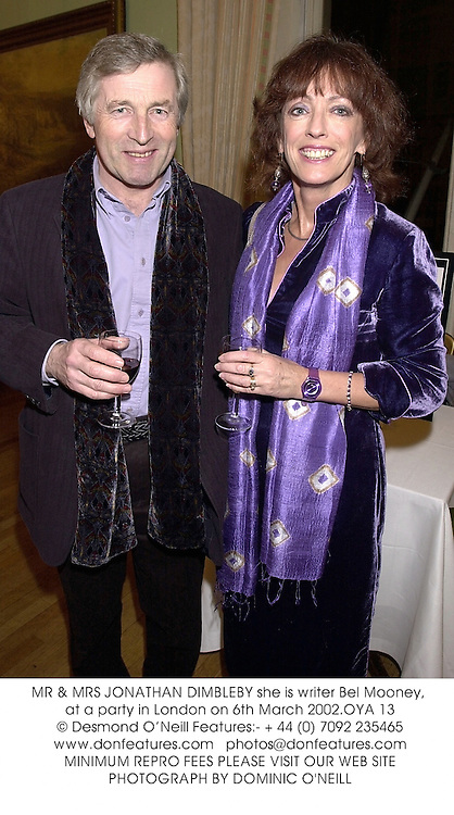 MR & MRS JONATHAN DIMBLEBY she is writer Bel Mooney, at a party in London on 6th March 2002.	OYA 13
