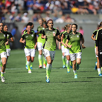 ORLANDO, FL - OCTOBER 25: Members of the USWNT run off the field after warmups during a women's international friendly soccer match between Brazil and the United States at the Orlando Citrus Bowl on October 25, 2015 in Orlando, Florida. (Photo by Alex Menendez/Getty Images) *** Local Caption ***