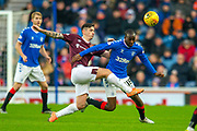 Jamie Walker (#10) of Heart of Midlothian FC tackles Glen Kamara (#18) of Rangers FC during the Ladbrokes Scottish Premiership match between Rangers FC and Heart of Midlothian FC at Ibrox Park, Glasgow, Scotland on 1 December 2019.