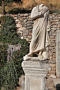 Statue on Curetes Street,<br /> Ephesus, Izmir, Turkey. Curetes Street was one of 3 main streets in Ephesus, leading from the Hercules Gate to the Celsus Library. It was a paved road lined with statues. Ephesus was an ancient Greek city founded in the 10th century BC, and later a major Roman city, on the Ionian coast near present day Selcuk. Picture by Manuel Cohen