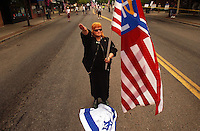 COEUR D ALENE, ID - JULY 17:  A member of the Aryan Nations gives a salute and steps on the Israeli flag during the World Congress Parade held in Coeur d'Alene, Idaho, on Saturday, July 17, 2004. About 40 supporters and members marched in downtown Coeur d'Alene for the Aryan World Congress.