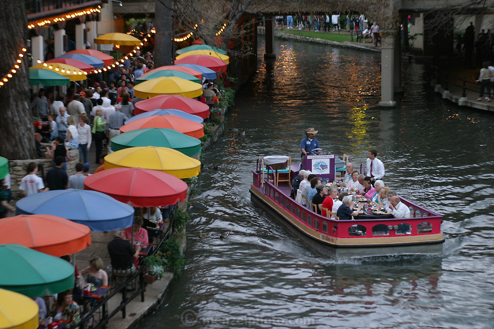Tourist dinner boat. The River Walk along the San Antonio River in downtown San Antonio, Texas.
