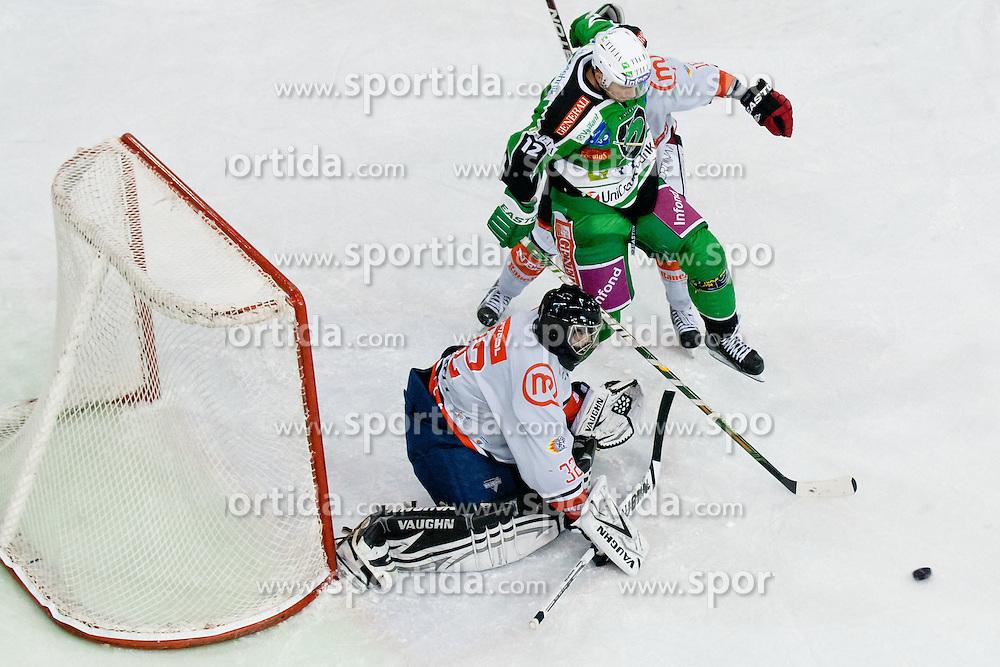 Petr Sachl (HDD Tilia Olimpija, #12) vs goalie Gasper Kroselj (HK Acroni Jesenice, #32) during ice-hockey match between HDD Tilia Olimpija and HK Acroni Jesenice in 23rd Round of EBEL league, on November 20, 2011 at Hala Tivoli, Ljubljana, Slovenia. HDD Tilia Olimpija won 5:2. (Photo By Matic Klansek Velej / Sportida)